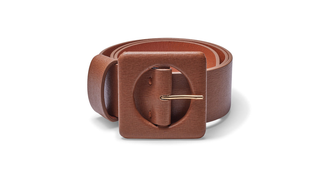Full view of Agnes Belt In Tan Leather. Check out the impeccable detailing on our favorite newer wide belt silhouette with oversized square buckle. This one's rendered in a gorgeous shade of tan saffiano leather for all your wardrobe needs.