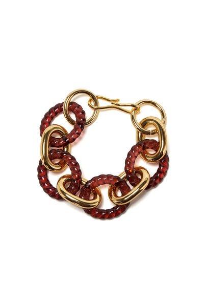 Thumbnail of The Mirrored Sea Bracelet, in Wine. Sleek rings of gold-plated brass and twisti...