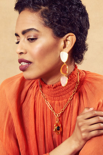 Thumbnail of model in the Oversized Prehistoric Earrings. Your wardrobe woes will officially...