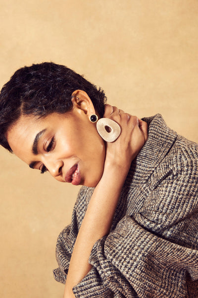 Thumbnail of model in the Clyde Earrings. Bring that sophisticated art class vibe to every l...