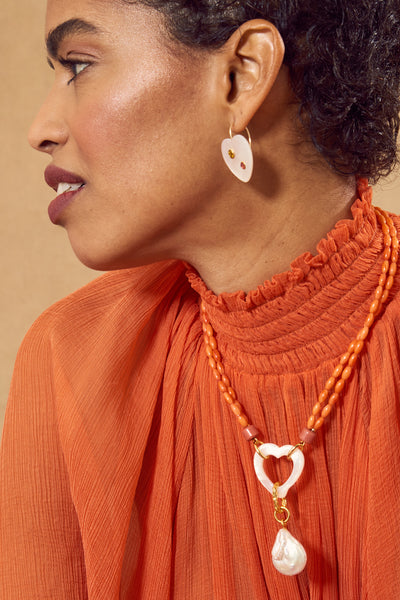 Thumbnail of model in the Mi Amor Earrings. In the mood for love? These dainty mother-of-pea...