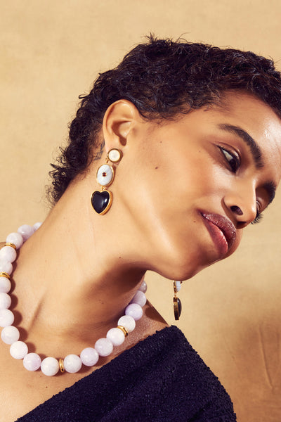Thumbnail of model in the Fontainebleau Earrings. Pretty, please. You'll be a sight to behol...