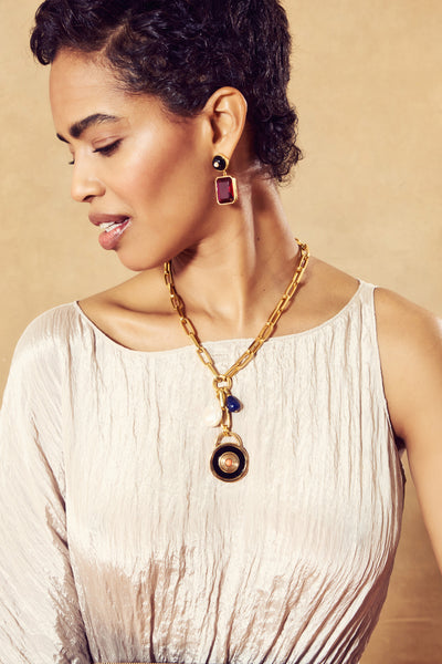 Thumbnail of model wearing the Ruby Tile Earrings. Strike it rich in this truly stunning pai...