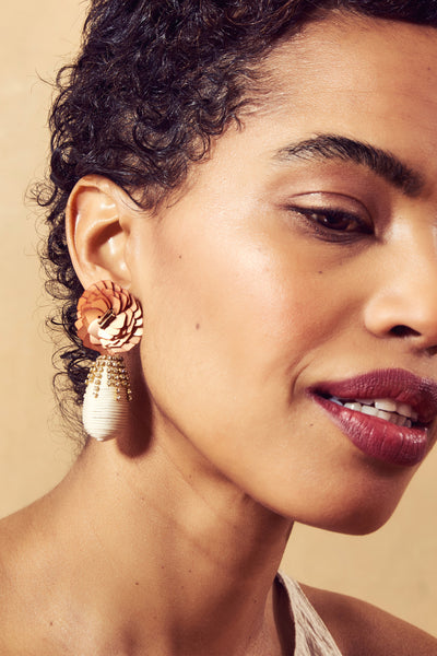 Thumbnail of model in the Le Pavilion Earrings. More, please. Gild the lily at your next soi...