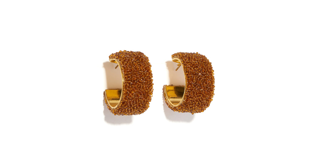 Full view of Beaded Margot Hoops in Amber. Lizzie ups the ante on the wide hoop earrings'...