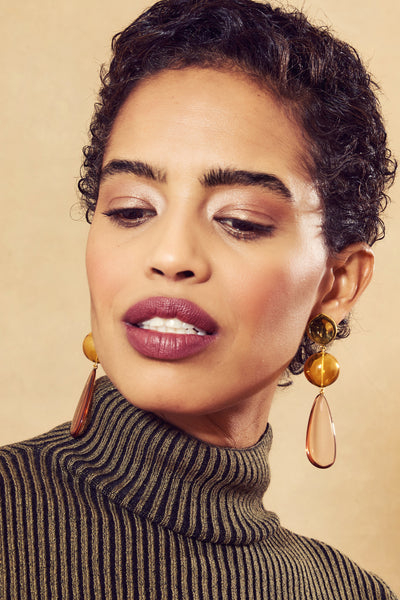 Thumbnail of model in the Miele Drop Earrings. The buzz is in: this pair of gold-plated earr...
