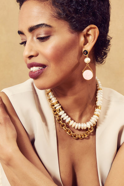 Thumbnail of model in the Niki Pearl Necklace. We love a great triple threat. Our convertibl...