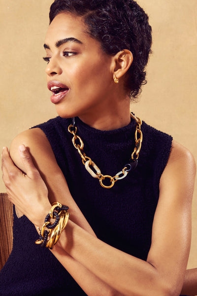 Thumbnail of model wearing the Clarice Collar. With a mix of chunky gold-plated brass, marbl...