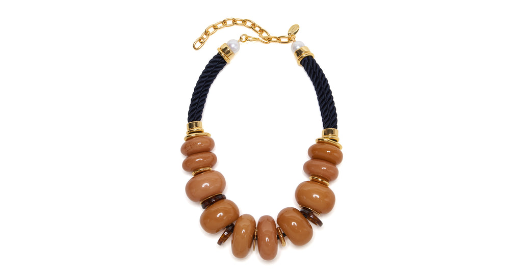 Full view of Botero Necklace In Honey. Inspired by the exaggerated volume of artist Fernando...