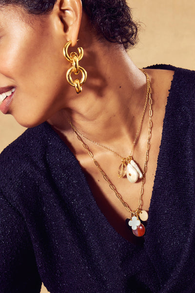 Thumbnail of model in the Rialto Charm Necklace. We don't usually like to play favorites, bu...