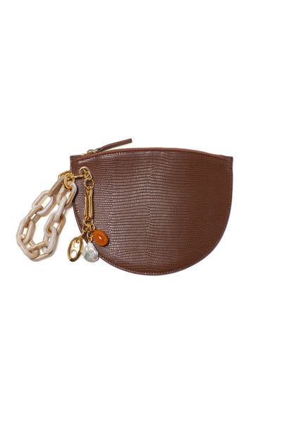 Thumbnail of Crescent Clutch In Dark Brown. It's not just a phase— choose between cream & or...