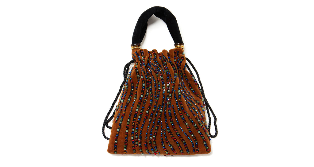 Full view of the Gala Wristlet in Amber Kaleidoscope. The latest take on our signature silho...