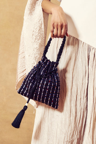 Thumbnail of model with the Gala Wristlet In Stevie Stripe. You'll be the life of any party ...