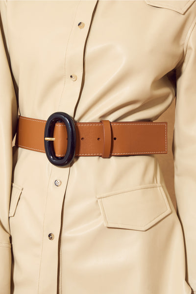 Thumbnail of model wearing the Icon Belt In Tan. The star of any outfit, the Icon Belt is th...