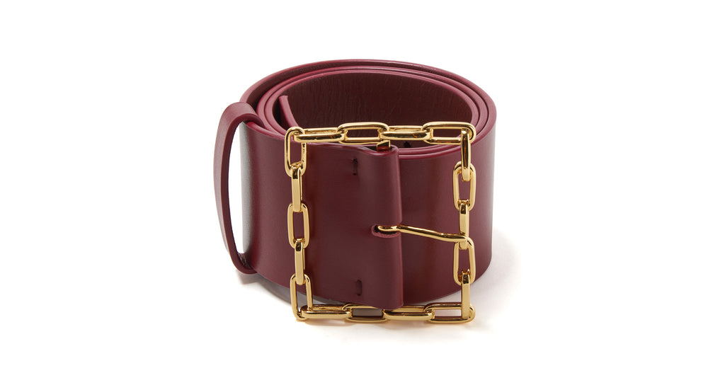 Full view of Geo Chain Belt In Burgundy. Link up your unique look with our wide belt in one-...