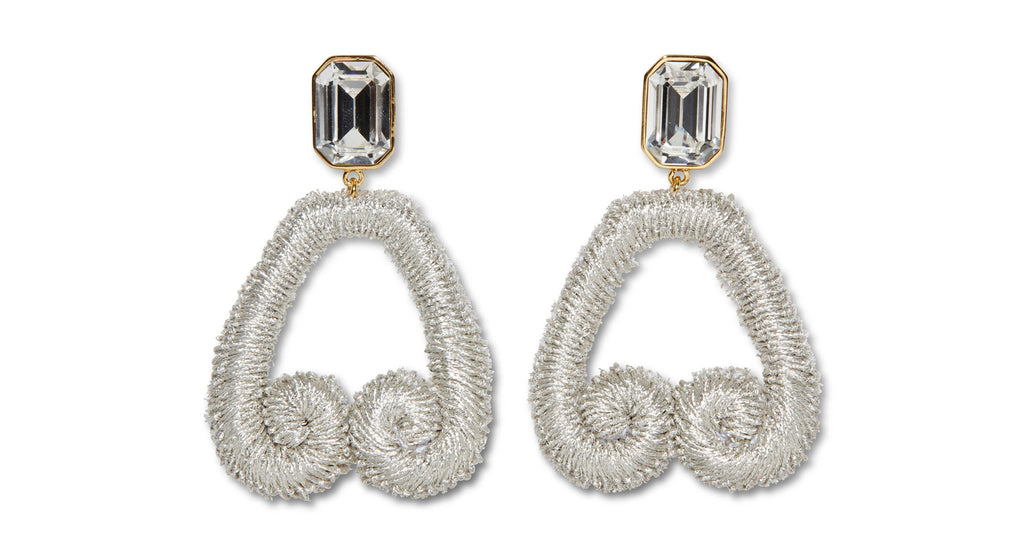 "Full view of Scroll Earrings In Silver. You'll want to keep scrolling in this pair of earrings in web-exclusive metallic silver. With embroidered ""scrolls,"" crystal tops, and (bonus!), easy-to-wear clip-on backs."