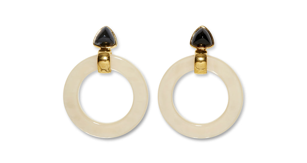 Full view of Cruise Hoops In Sand. Add an easy graphic pop to your fall wardrobe with our lightweight Cruise Hoop earrings in a web-exclusive, goes-with-everything colorway. In sand-dyed acrylic with black agate trillion tops.