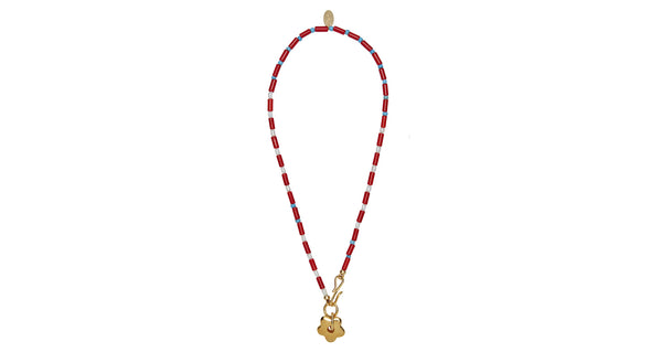 Full view of Rosa Rugosa Necklace. How to make a simple summer t-shirt look phenomenal? Layer up your accessories! Consider this bright single-strand beaded necklace with red African glass, pearls, and gold daisy pendant as your gateway piece.