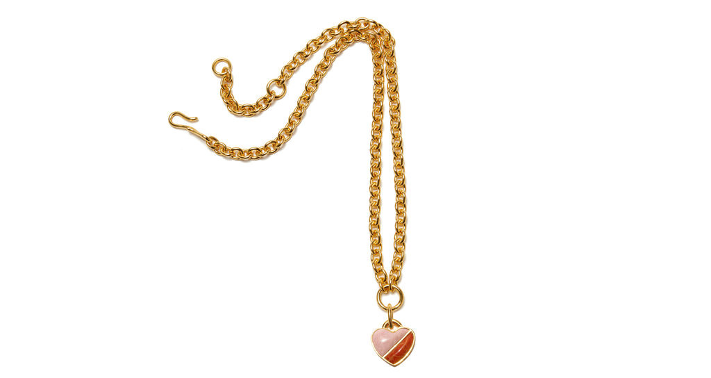 Full view of Before Sunrise Necklace In Sunset. Gift this beauty to your bestie, your mama, your sweetheart or yourself! Our favorite necklace has both substance (a luxe, thick link gold chain) and sentiment (a semi-precious heart charm in pink opal and coral).