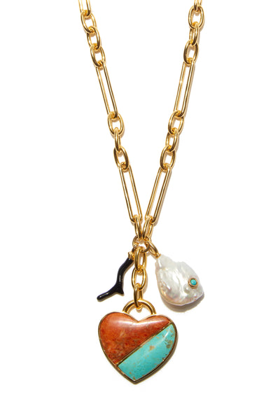 Thumbnail close-up of Venice Heart Necklace In Coastline. Rock that endless summer feeling in our exclusive long link chain necklace with a trio of beachy charms. Featuring a sweet semi-precious coral and turquoise heart pendant, black enamel branch coral, and freshwater pearl with turquoise inlay.