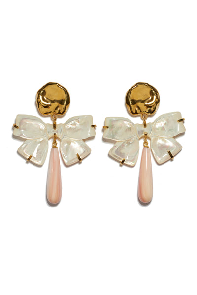 "Thumbnail of Charlotte Earrings. Feminine and unique, these gold ""coin"" earrings feel just right paired with a tulle dress -- or thrown on to sweeten up a chambray shirt. With hanging mother-of-pearl carved bows and light pink conch drops."