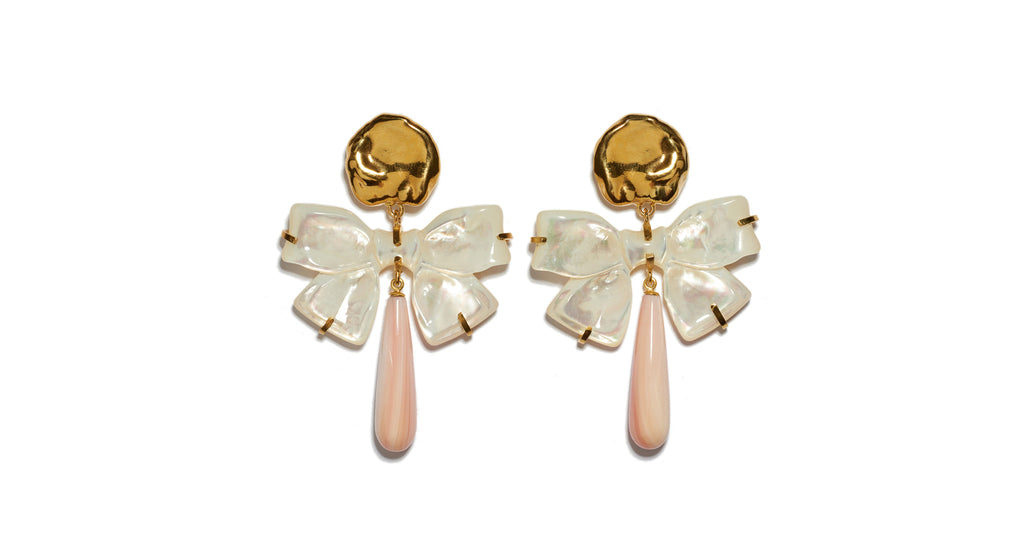 "Full view of Charlotte Earrings. Feminine and unique, these gold ""coin"" earrings feel just right paired with a tulle dress -- or thrown on to sweeten up a chambray shirt. With hanging mother-of-pearl carved bows and light pink conch drops."