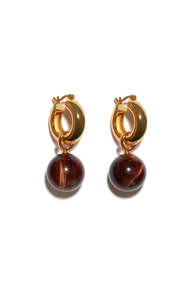 Thumbnail of Tiger Eye Hoops. We love the warm and timeless vibe of these gold-plated hoop earrings with tiger eye bead drops. Prediction: these will become your favorite everyday go-to pair.
