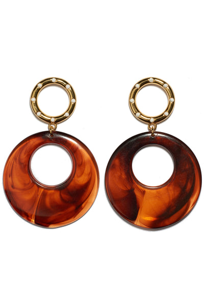Thumbnail detail of La Fonda Earrings. We love how these charmingly retro earrings fit seamlessly with contemporary styles. Gold and enamel rings with lightweight butterscotch-colored acrylic hoops.