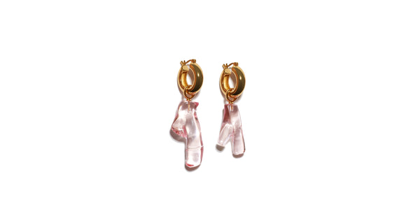 Full view of Pink Reef Earrings. Sleek, modern earrings with just the right amount of charm. The transparent acrylic coral adds an approachable amount of statement to our classic, gold plated hoops.