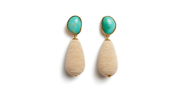 Full view of Turquoise Drop Earrings. We've playfully combined subtle beach vibes with high-style arts & crafts in these special earrings, with hand-cut turquoise cabochons and beige woven cord drops