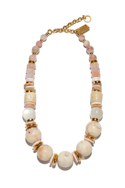 Thumbnail of Quarry Necklace. Our latest take on the sophisticated single-strand necklace, in lucite, morganite, quartz, conch and gold-plated beads. We love that this palette of soft neutrals will work with any pop of color in your closet.