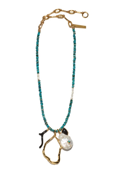 Thumbnail of Blue Horizon Necklace. Channel that elevated bohemian look in our favorite new charm necklace. Turquoise chip beads with organic shaped pearl, black agate and black enamel charms and adjustable gold chain closure.