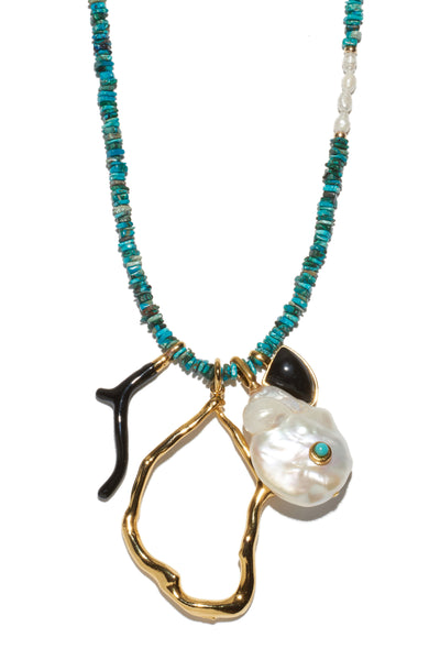 Thumbnail close-up of Blue Horizon Necklace. Channel that elevated bohemian look in our favorite new charm necklace. Turquoise chip beads with organic shaped pearl, black agate and black enamel charms and adjustable gold chain closure.