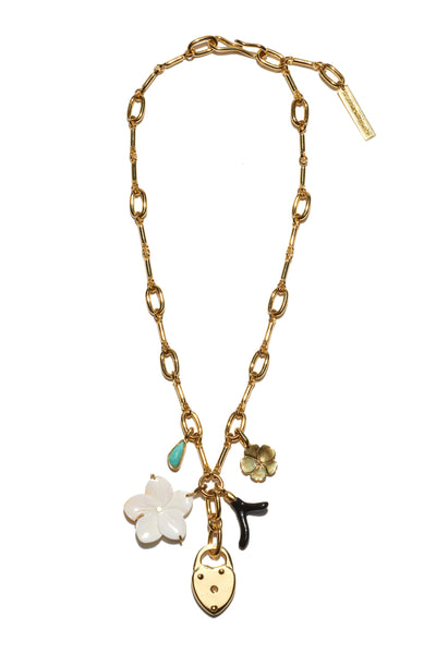 Thumbnail of Fiamma Necklace. The gold-plated chain link necklace was inspired by antique heirloom jewelry, with assorted charms that hold their own eclectic stories. With turquoise, pearl flower, gold locket and black enamel charms.