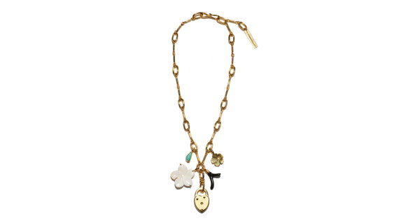 Full view of Fiamma Necklace. The gold-plated chain link necklace was inspired by antique heirloom jewelry, with assorted charms that hold their own eclectic stories. With turquoise, pearl flower, gold locket and black enamel charms.