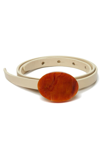 Thumbnail of Orbit Belt In Cream And Terra Cotta. We don't like to play favorites, but this is one accessory we can't wait to wear with everything. Adjustable, skinny cream leather belt with gold-plated and terra cotta-colored acrylic oval buckle.