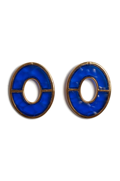 Thumbnail close-up of Blue City Earrings. She's electric! Amp up your basics in a pair of our large bisected oval earrings set with bright blue glass.