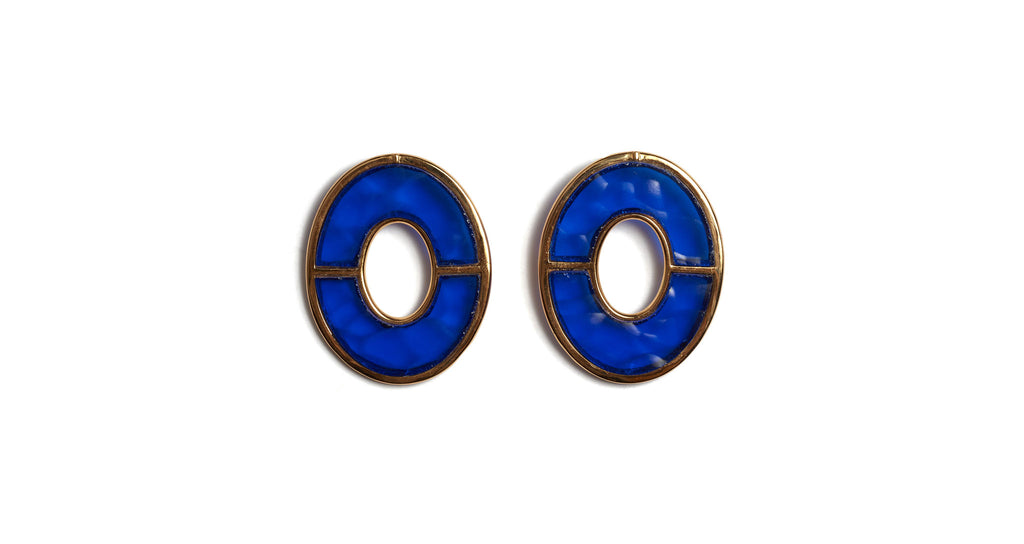 Full view of Blue City Earrings. She's electric! Amp up your basics in a pair of our large bisected oval earrings set with bright blue glass.
