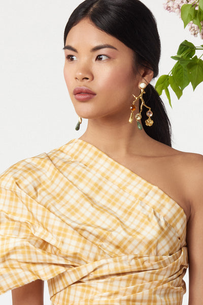 Thumbnail of model wearing Relic Chandelier Earrings. Perfectly balanced, these gold-plated brass coral-shaped chandelier earrings can be easily dressed up or down. Shop now, make a statement later. Featuring hanging faceted glass stones, gold-plated flower and hand charms, green jade drops and mother-of-pearl tops.