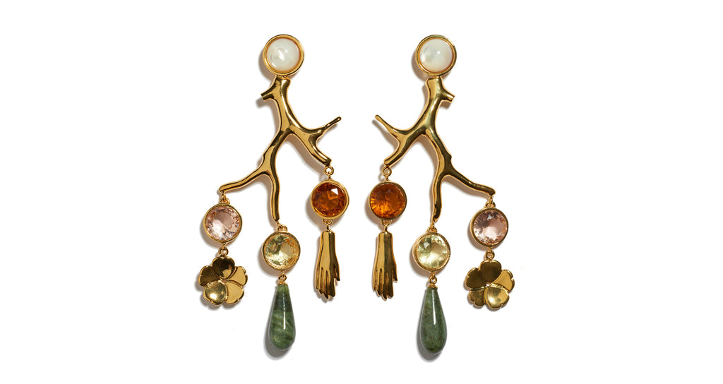 Full view of Relic Chandelier Earrings. Perfectly balanced, these gold-plated brass coral-shaped chandelier earrings can be easily dressed up or down. Shop now, make a statement later. Featuring hanging faceted glass stones, gold-plated flower and hand charms, green jade drops and mother-of-pearl tops.