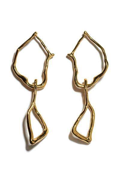 Thumbnail of Surrealist Earrings. Perfect for daytime or night wear, these shoulder-grazing abstract link earrings project elegance through oversized organic shapes. In gold-plated brass.