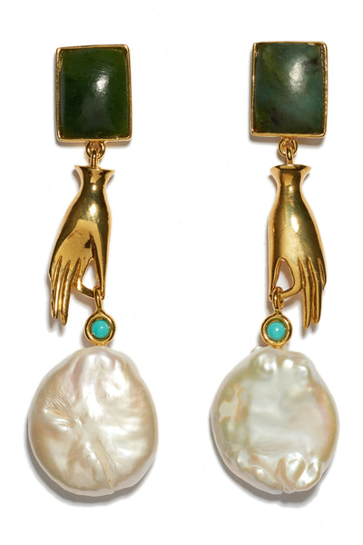 Thumbnail close-up of Gentlewoman Earrings. Shop the most elegant and whimsical earrings of the season. Gold-plated brass with dainty hand charm and large freshwater pearl, with green jade rectangle tops and turquoise stone detail.