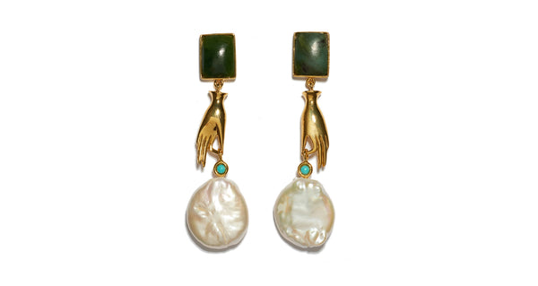 Full view of Gentlewoman Earrings. Shop the most elegant and whimsical earrings of the season. Gold-plated brass with dainty hand charm and large freshwater pearl, with green jade rectangle tops and turquoise stone detail.