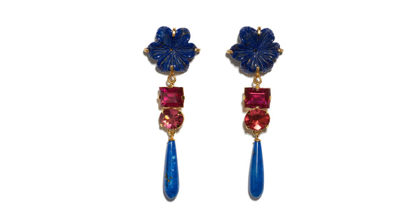 Full view of Baroque Flower Earrings. Gold-plated brass and carved lapis flowers with dark pink cut glass stones and hanging lapis drops. Add an elegant and unique pop of color to any outfit.