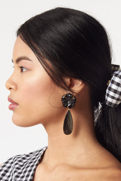 Thumbnail of model wearing Night Bloom Earrings. Day or night, these classic earrings will be surefire stunners. Black agate flowers with long black abalone shell drops.