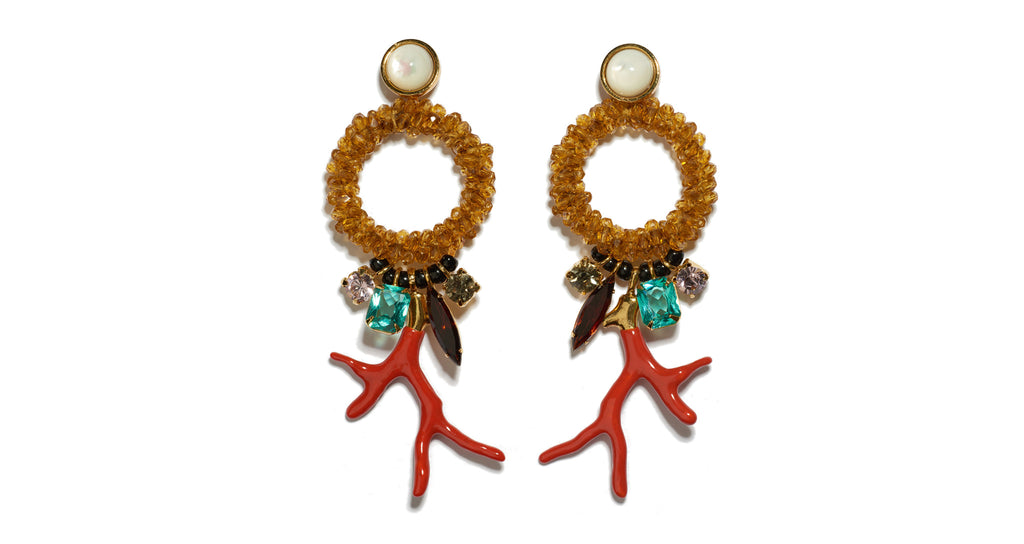 "Full view of Ornament Earrings. The season's most playful and unique statement-makers, for those who like to stand out in a crowd. Gold-plated brass and amber glass-beaded hoop earrings with vintage glass stones, red enameled ""branch coral"" casting and mother-of-pearl tops."