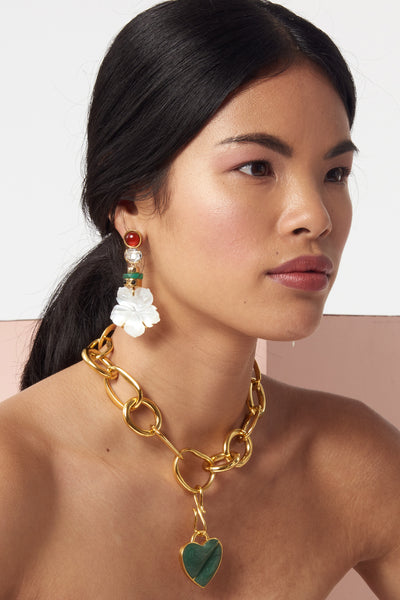 Thumbnail of model wearing the Margherita earrings. Found: the perfect vacation earrings. Whether island-hopping or dressing up your 'stay-cation', we think you'll agree. Gold-plated brass earrings with faceted crystal, amazonite beads and carved mother-of-pearl flower drops and semiprecious carnelian tops.