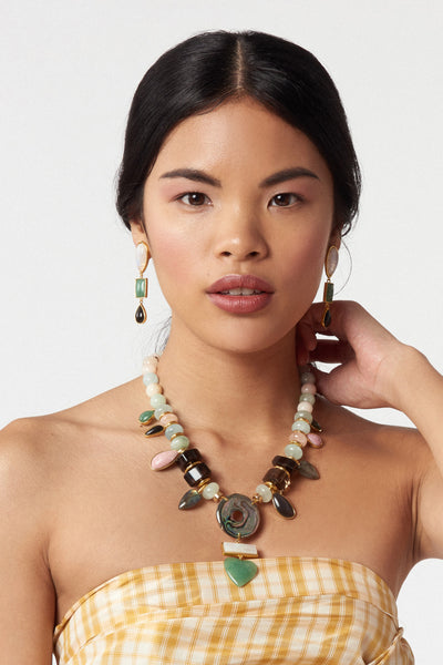 Thumbnail of model wearing the Color Field Earrings. Gold-plated brass linked earrings with semiprecious moonstone, green quartz and black agate cabochons. These are classic drop earrings with a geometric flair.