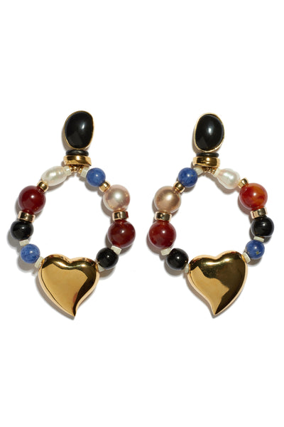 Thumbnail of Candy Heart Earrings. Mixed-media pearl, glass and sodalite beaded hoop earrings with gold-plated heart charms and black agate stone tops. A colorful statement earring that's surprisingly easy to wear.