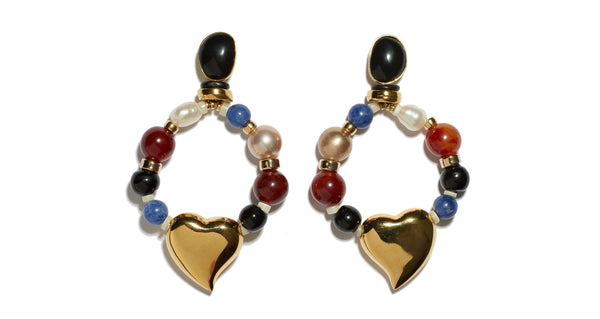 Full view of Candy Heart Earrings. Mixed-media pearl, glass and sodalite beaded hoop earrings with gold-plated heart charms and black agate stone tops. A colorful statement earring that's surprisingly easy to wear.
